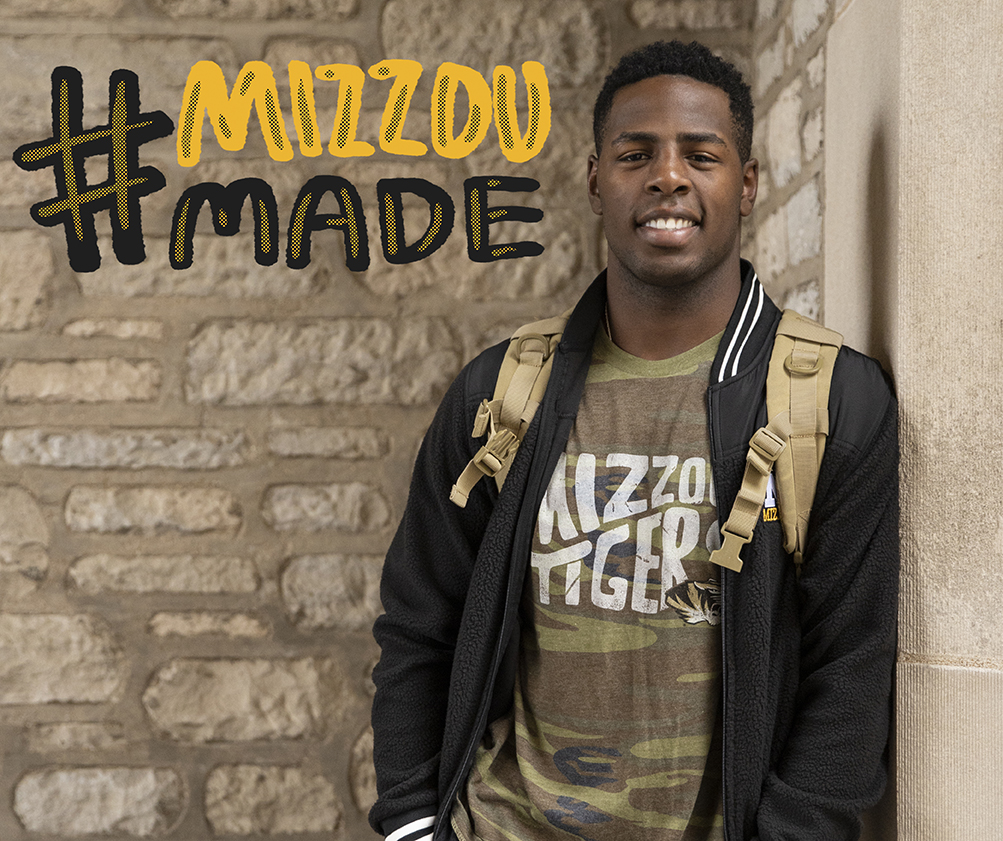 Student standing by Memorial Union with a black and gold MizzouMade graphic sticker placed on the background