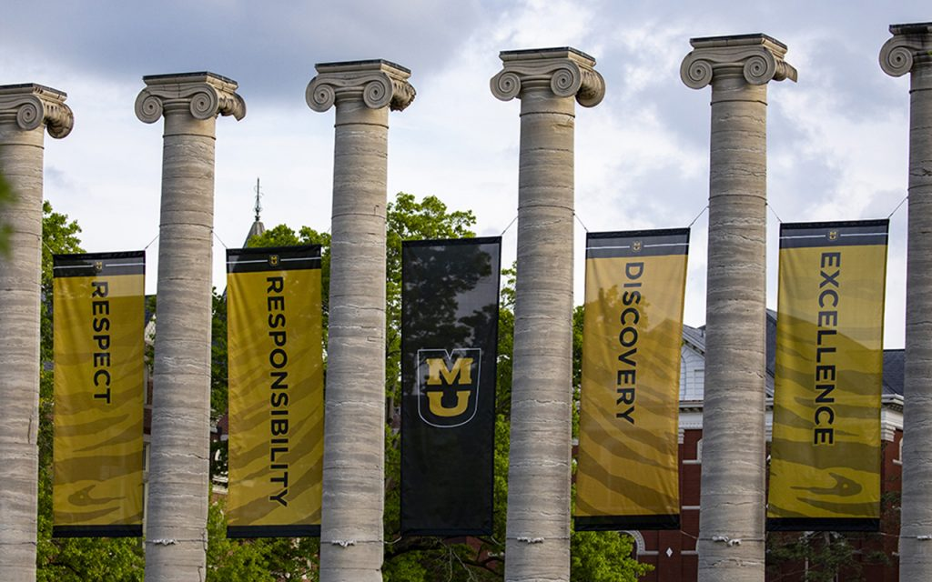 Banners with the words Respect, Responsibility, Discovery and Excellence hang on the Columns.